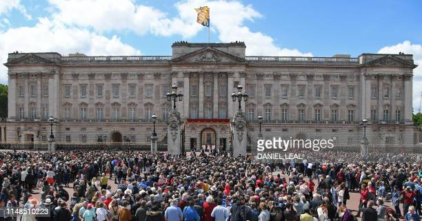 Crowds gather outside the gates as members of the Royal Family are expected on the balcony of Buckingham Palace to watch a flypast of aircraft by the...
