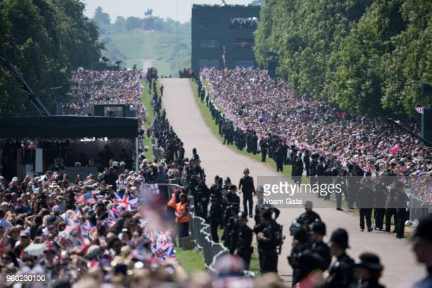 Crowds gather outside the wedding of Prince Harry Harry to Ms. Meghan Markle at Windsor Castle on May 19, 2018 in Windsor, England. Prince Henry...