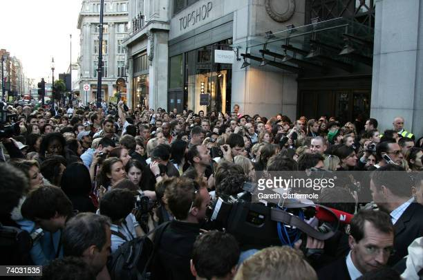 Crowds gather outside Top Shop on Oxford Street during the shopping preview of the Kate Moss collection on April 30, 2007 in London.