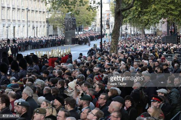 Crowds gather prior to the annual Remembrance Sunday memorial at the Cenotaph on Whitehall on November 12 2017 in London England The Royal Family...