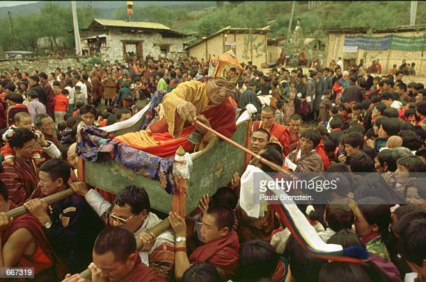 Crowds gather to be blessed with a wand by the highly respected Rinpoche Beryu Tulku of Nepal during the Supreme Prayer festival called 'Melam...
