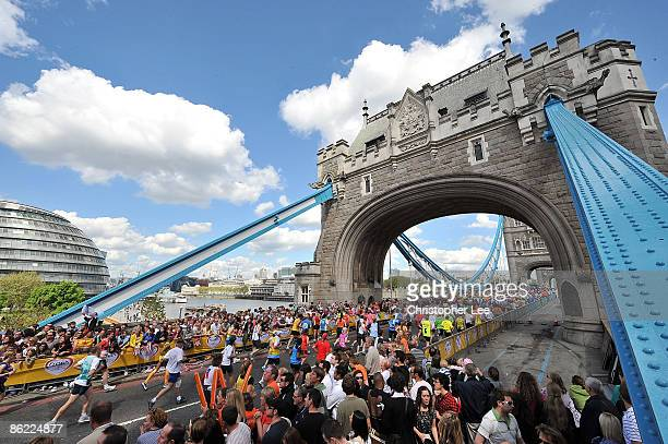 Crowds gather to cheer on the fun runners at Tower Bridge during the 2009 Flora London Marathon held in London on April 26 2009 in London England