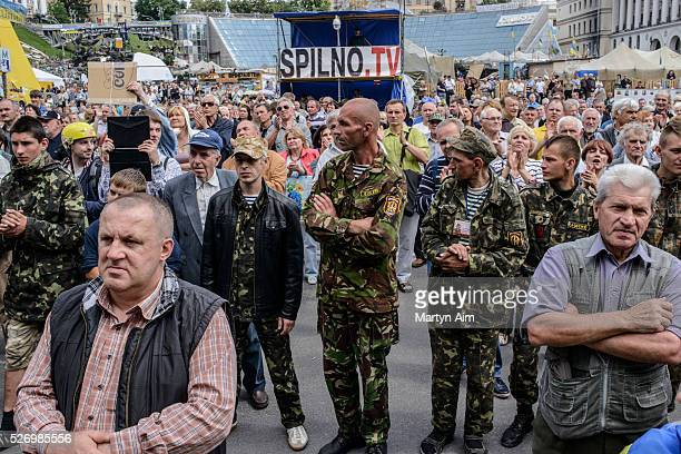 Crowds gather to commemorate the Ukrainian soldiers killed when the cargo plane they were travelling in was shot down by proRussian separatists...