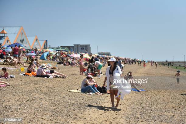Crowds gather to enjoy the warm sunny weather on Jubilee beach on July 18, 2021 in Southend-on-Sea, England. A heat-heath warning has been issued for...