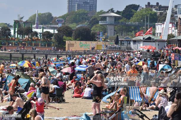 Crowds gather to enjoy the warm sunny weather on Jubilee beach on May 31, 2021 in Southend, England. Today's bank holiday Monday brings highs of 77F...