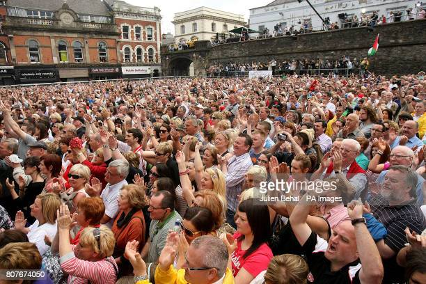Crowds gather to hear the findings of the longawaited Saville Inquiry report into Bloody Sunday outside the Guildhall in Londonderry