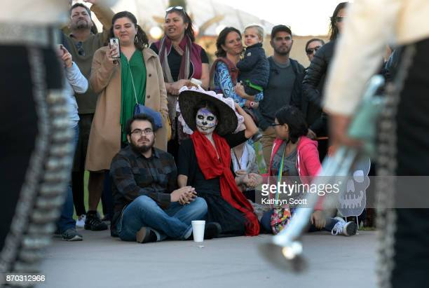 Crowds gather to listen to the Mariachi Juvenil band during the Denver Botanic Gardens 'Dia de los Muertos' Day of the Dead celebration on November 4...