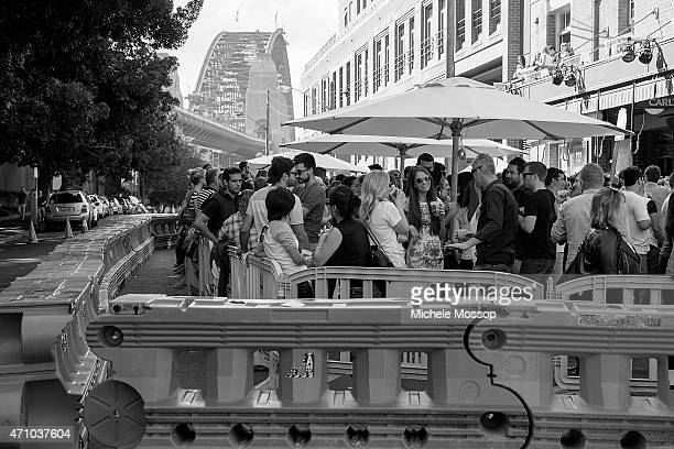 Crowds gather to play Twoup at the Glenmore Hotel in the Rocks on April 25 2015 in Sydney Australia Twoup is a traditional Australian gambling game...
