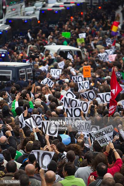 Crowds gather to protest against the government's austerity measures in the city centre of Madrid Spain on Tuesday Sept 25 2012 Thousands of...