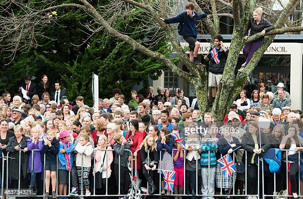 Crowds gather to see Catherine, Duchess of Cambridge and Prince William, Duke of Cambridge attend a wreathlaying service at the War Memorial in...