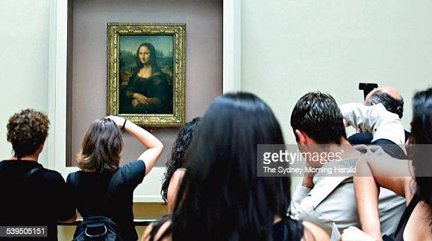 Crowds gather to view the Mona Lisa at the Musee du Louvre Paris 7 August 2003 SMH Picture by TIM CLAYTON