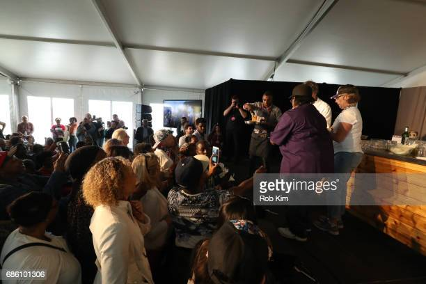 Crowds gather to watch a cooking demonstration at Harlem EatUp's Third Annual Festival Weekend at Morningside Park on May 20 2017 in New York City