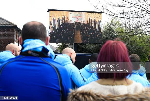 Crowds gather to watch a live feed of the service outside St Mary's Church in Manchester on April 10 2019 in Manchester England