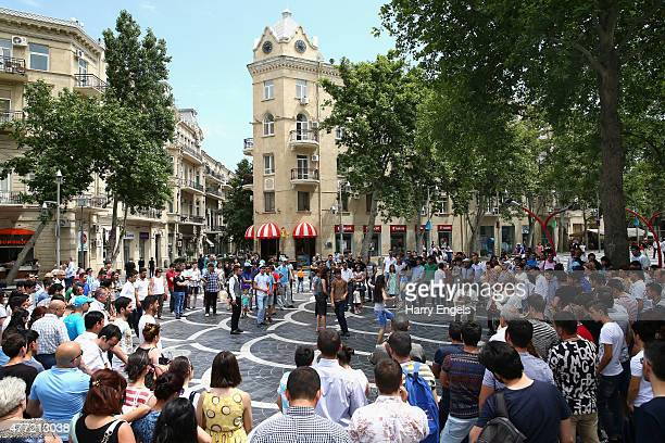 Crowds gather to watch local people dance to traditional Azerbaijani music in Fountains Square in Baku City Centre on June 15 2015 in Baku Azerbaijan