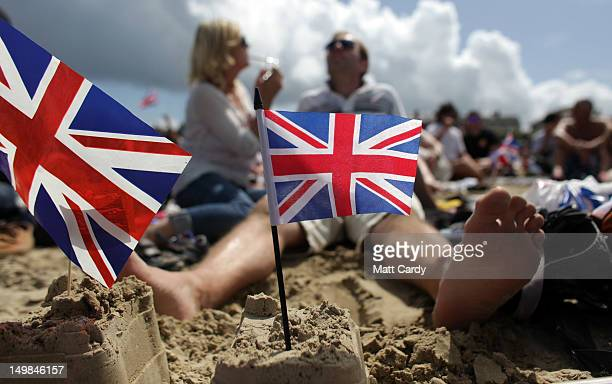 Crowds gather to watch Olympic sailing on large screens erected on the beach on August 5 2012 in Weymouth England Ben Ainslie of Great Britain became...