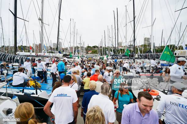 Crowds gather to watch the boats sail out of the CYCA during the 2017 Sydney to Hobart on December 26 2017 in Sydney Australia