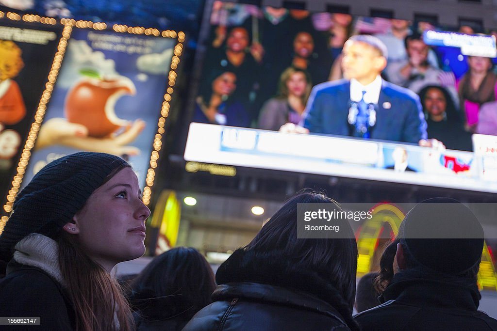 Crowds gather to watch U.S. President Barack Obama give his acceptance speech on a screen at Times Square in New York, U.S., early on Wednesday, Nov. 7, 2012. Obama, the post-partisan candidate of hope who became the first black U.S. president, won re-election today by overcoming four years of economic discontent with a mix of political populism and electoral math. Photographer: Michael Nagle/Bloomberg via Getty Images