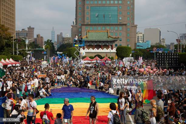 Crowds gather with their rainbow flags at the start of the Taiwan Pride event. Over 100 000 people were expected at the 2017 Taiwan LGBT Pride. The...