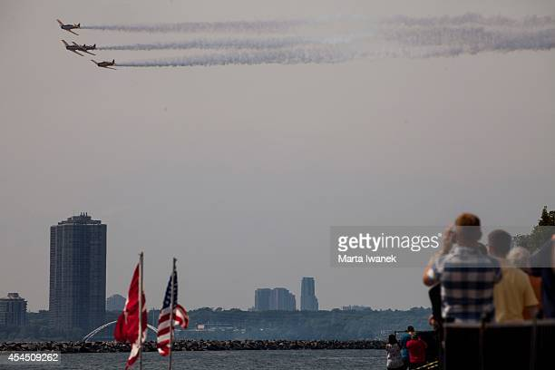 Crowds gathered at the CNE to watch the Canadian Snowbirds perform at The Canadian International Air Show in Toronto August 30 2014