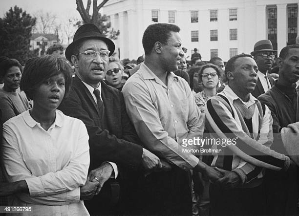 Crowds gathered to hear Dr. Martin Luther King, Jr. Deliver a speech on the steps of the Alabama State House, at the culmination of the Selma to...