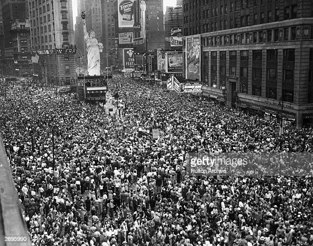 Crowds gathering in Times Square to celebrate the news of Japan's surrender on V-J Day, New York City.