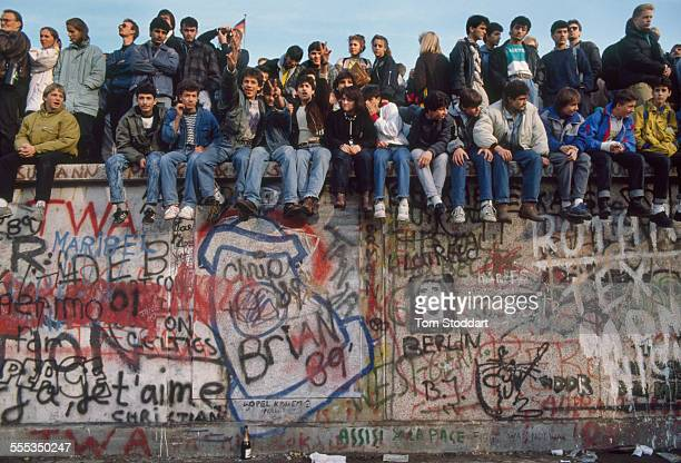 Crowds gathering on the Berlin Wall near the Brandenburg Gate on November 10 the day the Wall fell