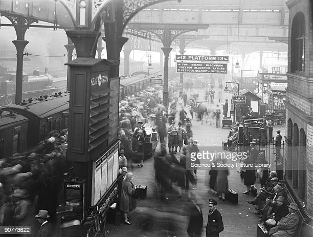 Crowds getting onto a train at Manchester Victoria The passengers are probably going out for the day as it is a public holiday The railways put on...