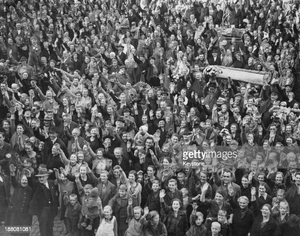 Crowds give the Nazi salute as they listen to the Sudeten German Proclamation in the main square of Eger in the Sudetenland, Czechoslovakia, 22nd...