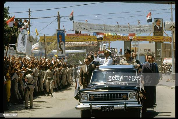 Crowds greeting limousine carrying Israeli Prime Minister Menachem Begin US Secretary of State Cyrus Vance and Egyptian President Anwar Sadat