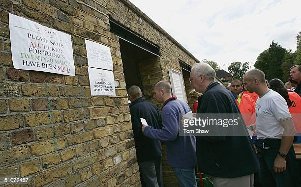 Crowds head in to the ground as a sign denotes the match is sold out during the Middlesex v Surrey Twenty20 Cup match at Lords on July 15 2004 in...