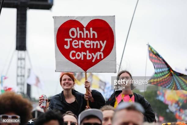 Crowds hold signs as they are excited by Jeremy Corbyn as he speaks on the Pyramid stage on day 3 of the Glastonbury Festival 2017 at Worthy Farm...