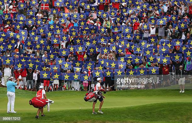 Crowds hold up Go Europe placards for the European Ryder Cup Team Captain Darren Clarke on the 16th green during the second round of Made in Denmark...