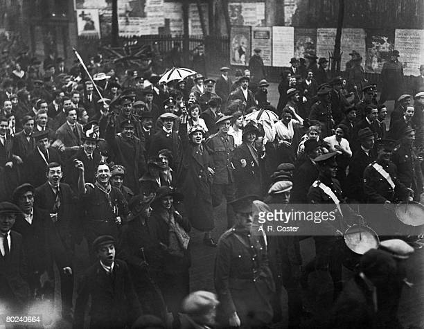Crowds in a London street celebrate the end of World War I on Armistice Day 11th November 1918