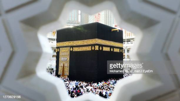 crowds in al harm mosque around kaaba - mecca stock pictures, royalty-free photos & images