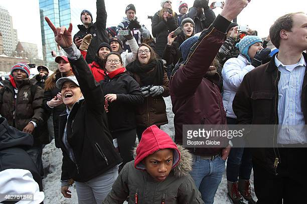 Crowds in Copley Square stood on snow banks to see their heroes The New England Patriots have a duck parade in snowchoked Boston