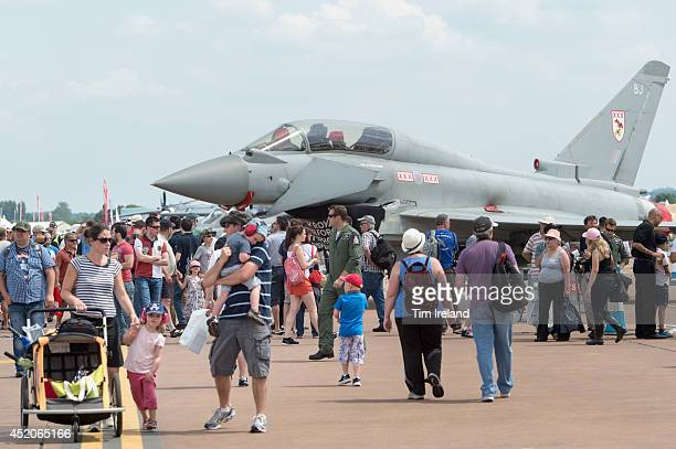 Crowds in front of a Eurofighter Typhoon during the Royal International Air Tattoo at RAF Fairford on July 12, 2014 in Fairford, England. The Royal...
