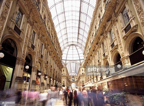crowds in galleria vittorio emmanuelle, milan, italy - travel14 stock pictures, royalty-free photos & images