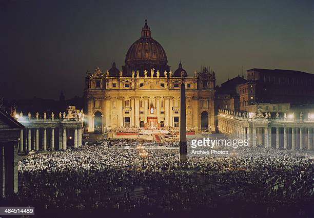 Crowds in St Peter's Square in front of St Peter's Basica in Vatican City Italy circa 1960