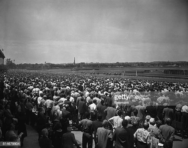 Crowds in the grandstand watch the first race of the day at Belmont Park which was won by Tom's Lark New York June 11 1960
