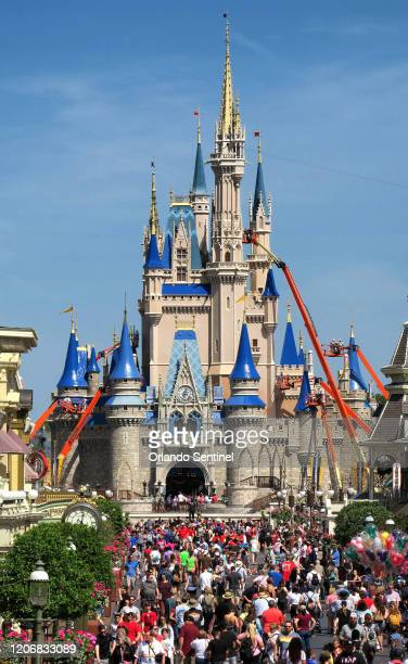 Crowds jam Main Street USA in front of Cinderella Castle in the Magic Kingdom on Thursday March 12 2020 at Walt Disney World in Lake Buena Vista Fla...