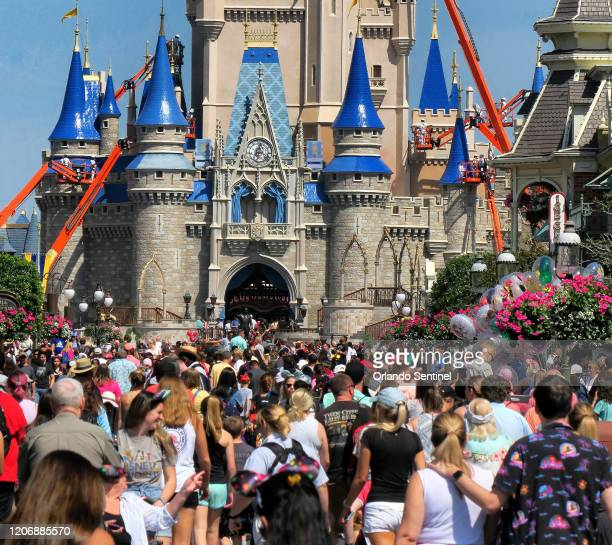 Crowds jam Main Street USA in front of Cinderella Castle in the Magic Kingdom at Walt Disney World in Lake Buena Vista Fla Thursday March 12 2020...