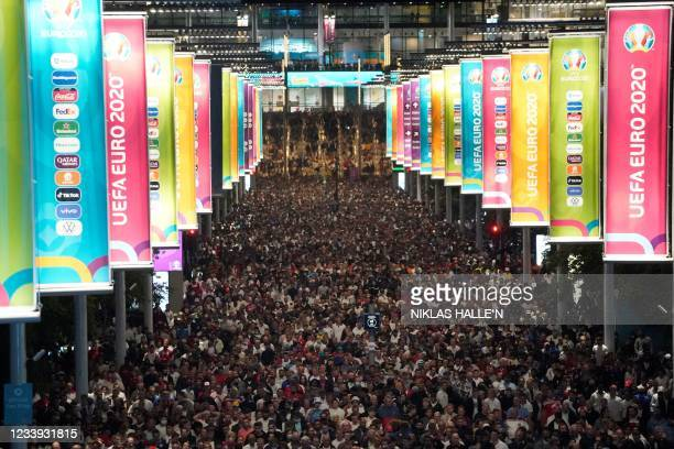 Crowds leave Wembley Stadium after Italy wins the UEFA EURO 2020 final football match between England and Italy in northwest London on July 11, 2021.