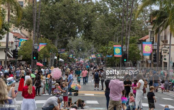Crowds line State Street in anticipation of the annual colorful Summer Solstice Parade an event that has evolved into equal parts of Mardi Gras Pride...
