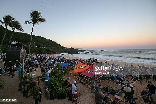 Crowds line the beach and surrounding areas before sunrise in anticipation of the 'The Quiksliver In Memory Of Eddie Aikau' at Waimea Bay on February...