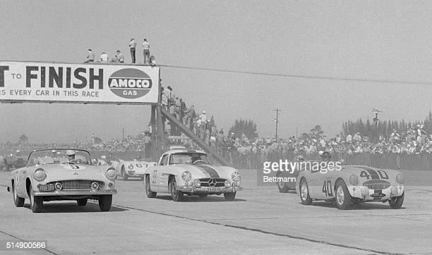Crowds line the fence at the start of the Florida International TwelveHour Grand Prix Endurance Race at Sebring Florida In car is Fred Scherer of...