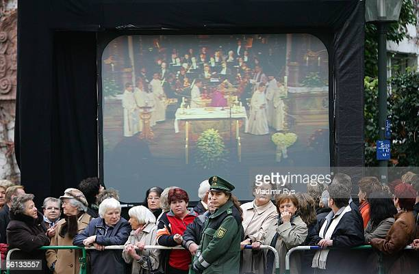 Crowds line the funeral route in front of a big screen showing the funeral service of Aenne Burda on November 10 2005 in Offenburg Germany Aenne...