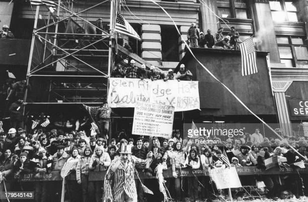 Crowds line the route on the tickertape parade to mark the return of the freed US citizens from the Iran hostage crisis Lower Broadway New York City...