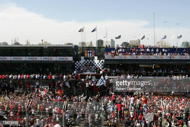 Crowds line the start finish straight as they watch the podium ceremony for the Australian Formula One Grand Prix at the Albert Park Circuit on March...