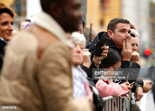 Crowds line the streets during the former Collingwood legend Lou Richards state funeral at St Paul's Cathedral on May 17 2017 in Melbourne Australia