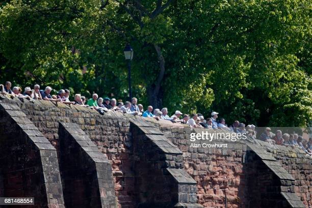 Crowds line the walls to watch the racing at Chester Racecourse on May 10 2017 in Chester England